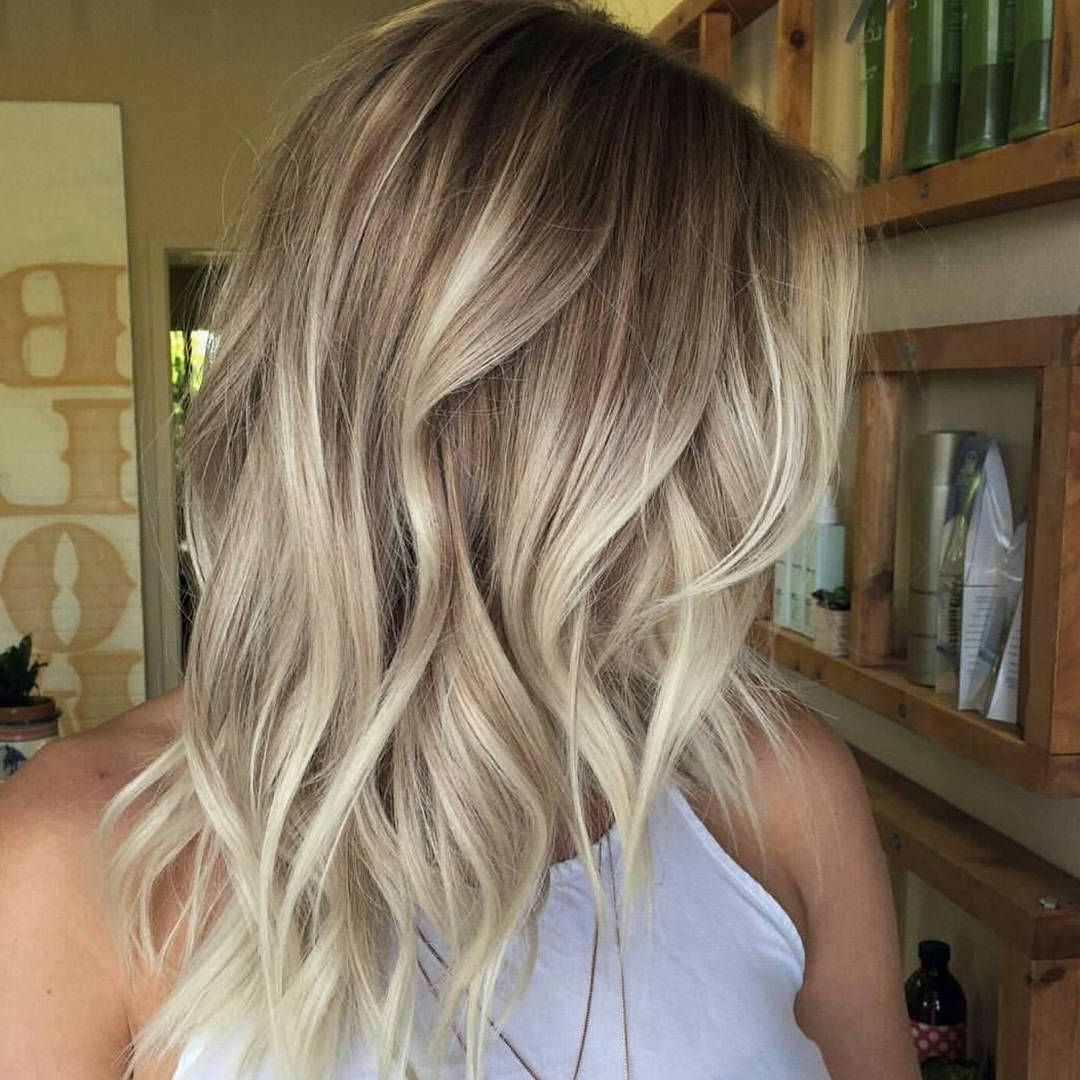 Wavy Mid Length Cafe Au Lait–colored Hair With Creamy Blonde Regarding Preferred Cream Colored Bob Blonde Hairstyles (View 2 of 20)