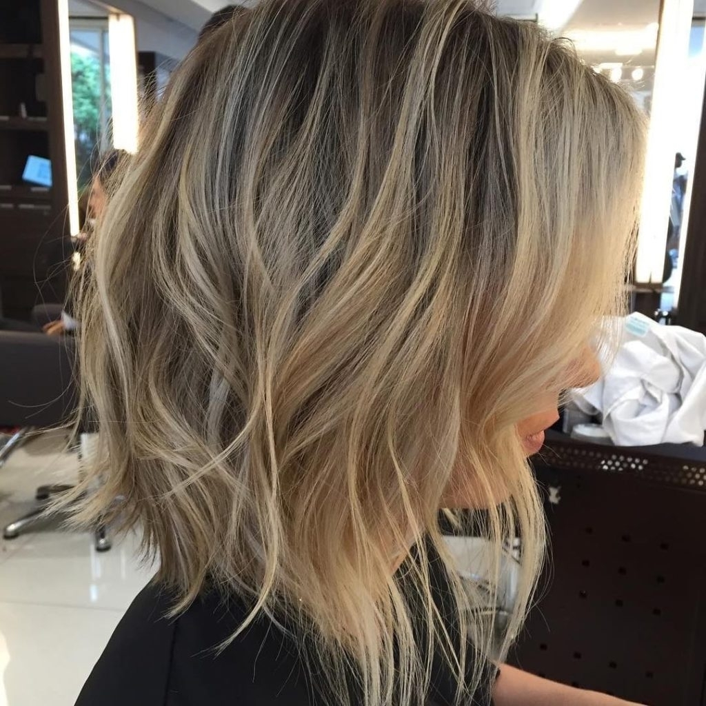 Well Liked Gently Angled Waves Blonde Hairstyles Pertaining To Women's Long Shaggy Angled Bob With Tousled Waves (View 5 of 20)