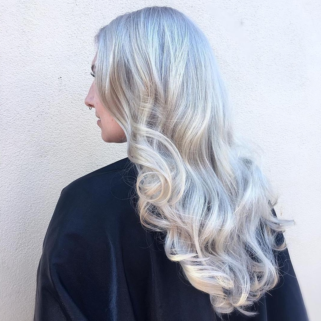 Wella Stories Within Widely Used Dark Roots And Icy Cool Ends Blonde Hairstyles (View 14 of 20)