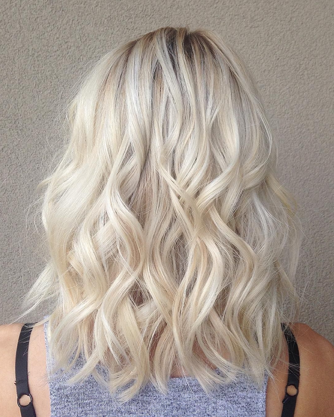 Widely Used Casual Bright Waves Blonde Hairstyles With Bangs Intended For How To Take Care Of Hair After Temporary Straightening And Keep It (View 19 of 20)