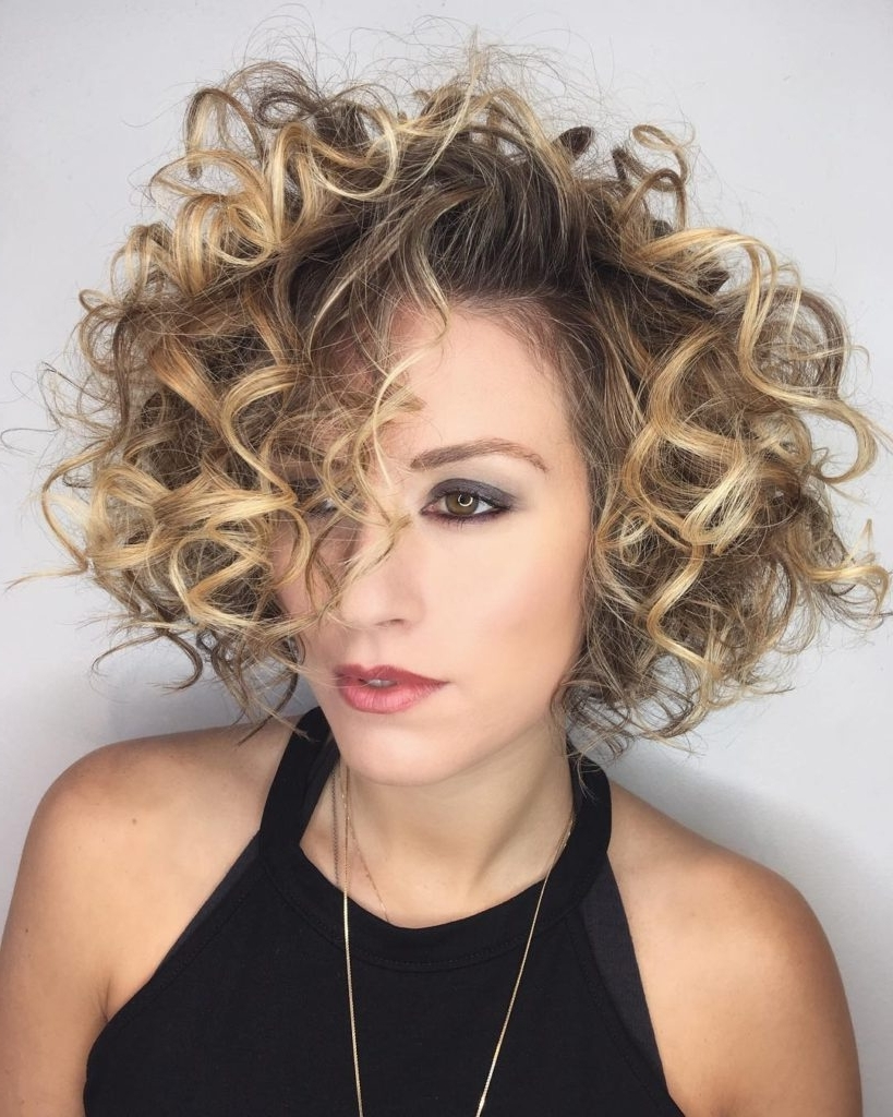 Women's Shaped Bob With Large Messy Spiral Curls And Blonde Balayage Pertaining To Fashionable Medium Blonde Bob With Spiral Curls (View 8 of 20)