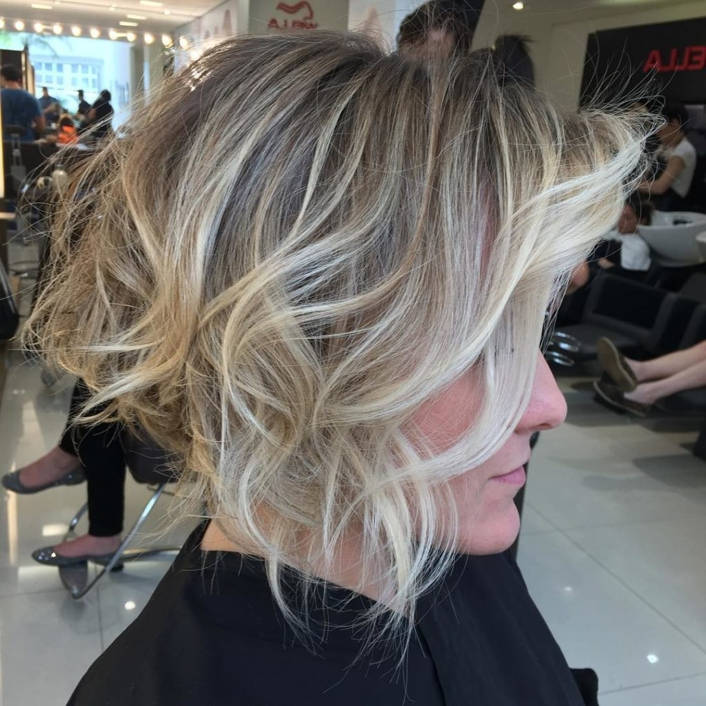 Women's Short Stacked Bob With Messy Voluminous Waves And Balayage For Most Popular Angled Wavy Lob Blonde Hairstyles (View 16 of 20)