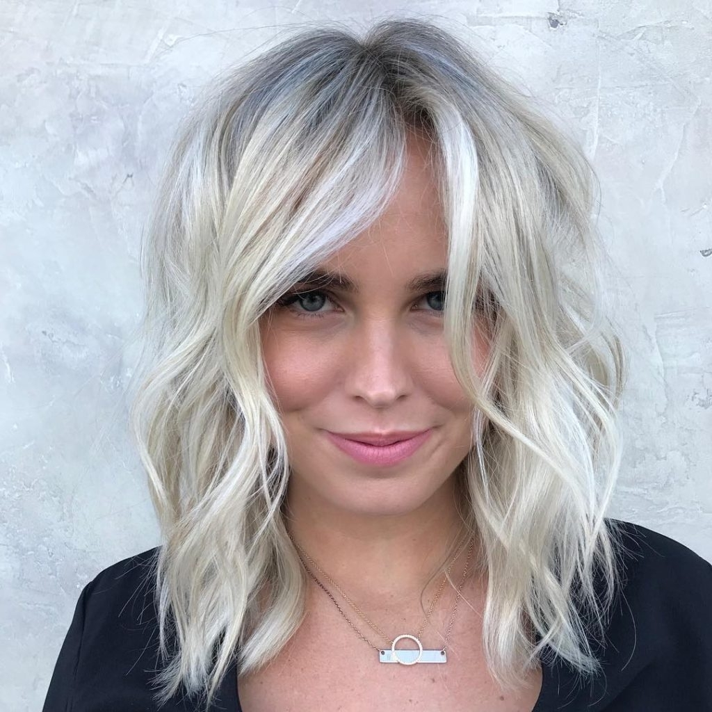 Women's Soft Blonde Lob With Undone Textured Waves And Babylights Regarding Best And Newest Soft Ash Blonde Lob Hairstyles (View 20 of 20)