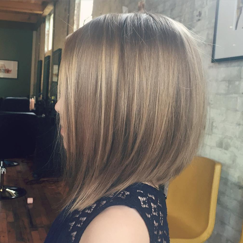 50 Cute Haircuts For Girls To Put You On Center Stage Intended For Angled Burgundy Bob Hairstyles With Voluminous Layers (View 16 of 20)