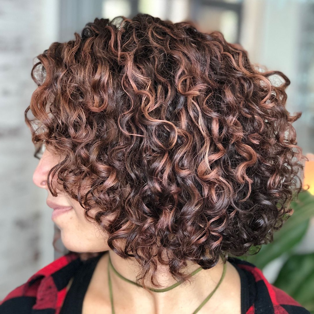 Featured Photo of Curly Golden Brown Pixie Hairstyles
