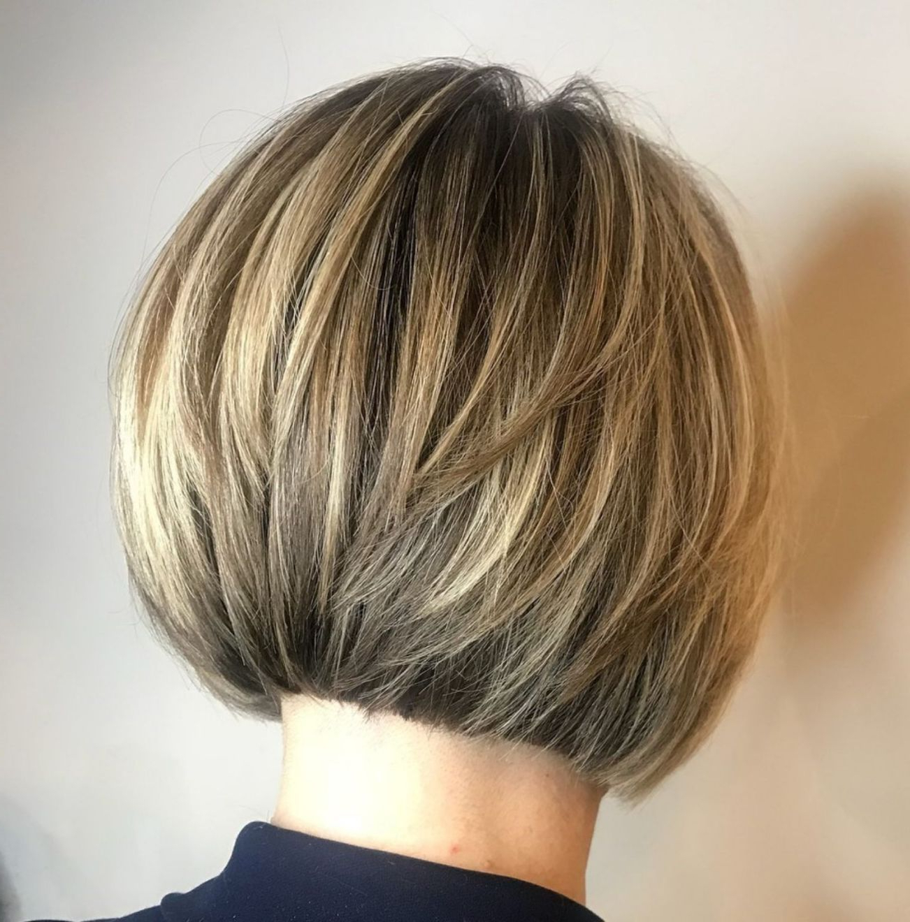 60 Layered Bob Styles: Modern Haircuts With Layers For Any In Dynamic Tousled Blonde Bob Hairstyles With Dark Underlayer (View 8 of 20)