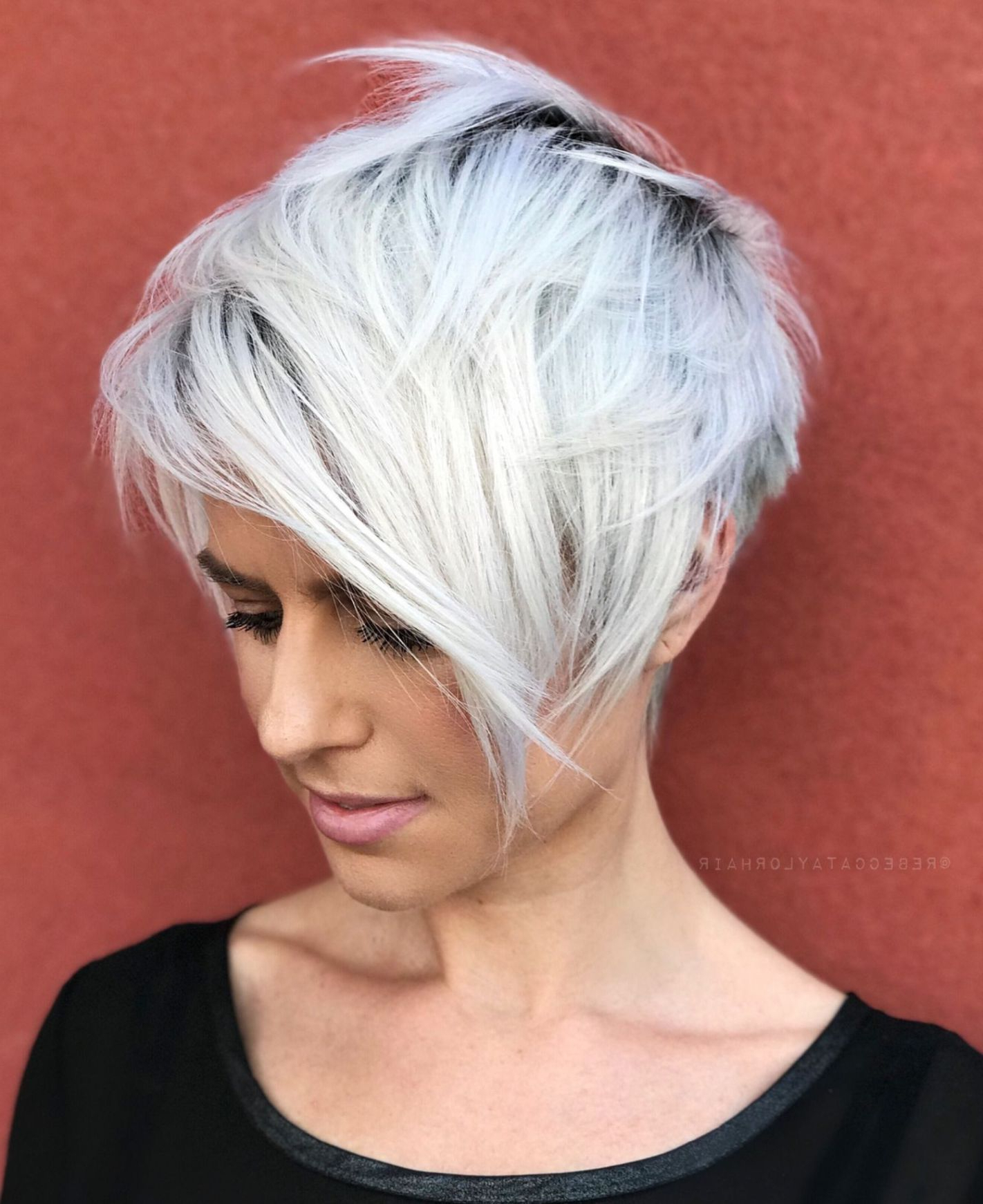 Featured Photo of Layered Pixie Hairstyles With An Edgy Fringe