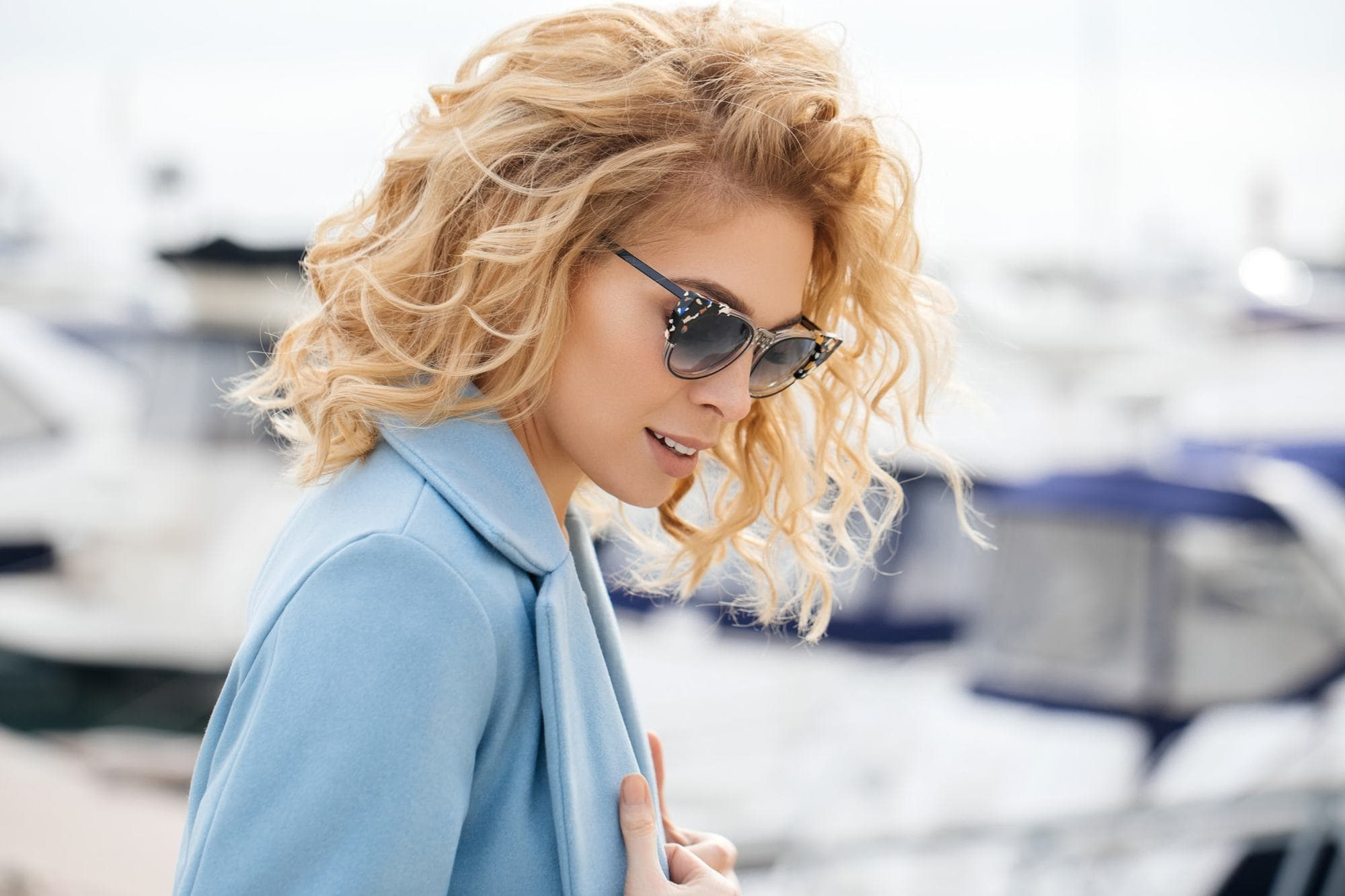 Bold And Beautiful: 16 Ways To Wear Blonde Curly Hair For White Blonde Curly Layered Bob Hairstyles (View 16 of 20)