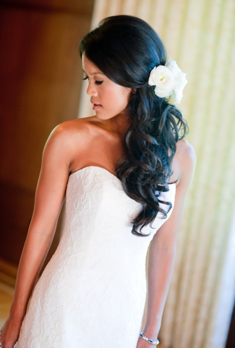 Brides Inside Fashionable Wavy Ponytails With Flower (View 5 of 20)