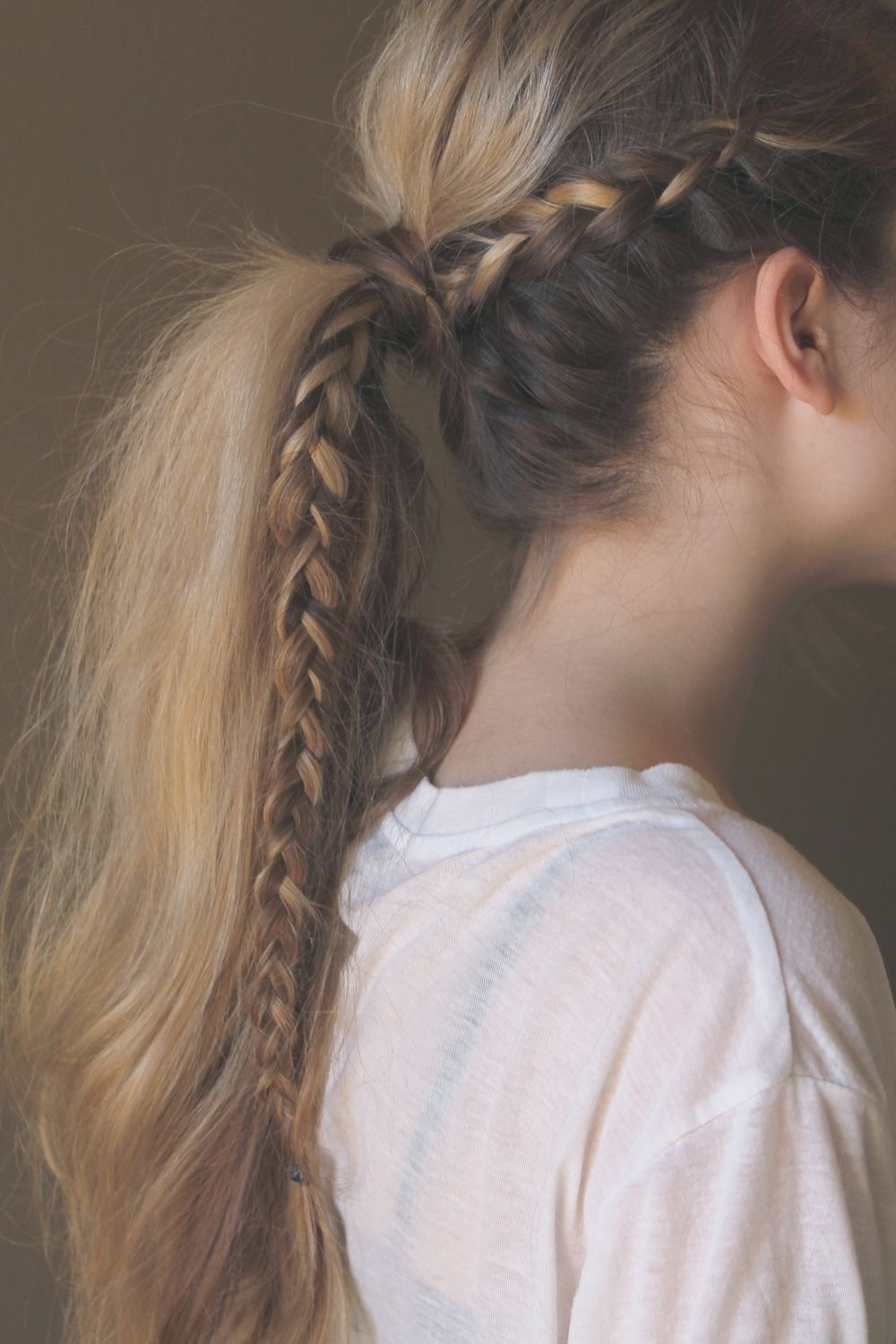 Preferred Intricate And Messy Ponytail Hairstyles Pertaining To A Messy Braided Ponytail Perfect For Weekend Wandering (View 16 of 20)
