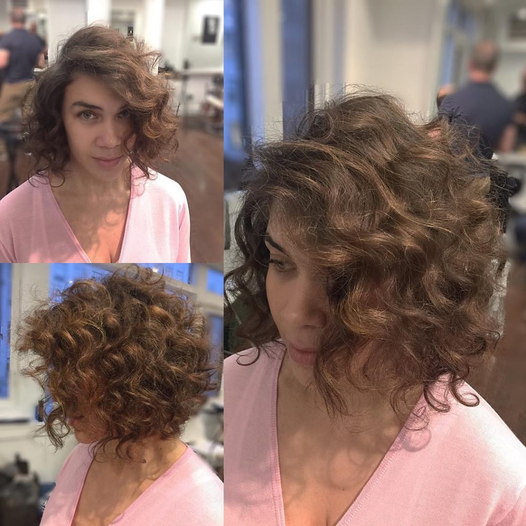 Women's Brunette Angled Bob With Large Soft Curls And Side Part For Side Parted Messy Bob Hairstyles For Wavy Hair (View 20 of 20)