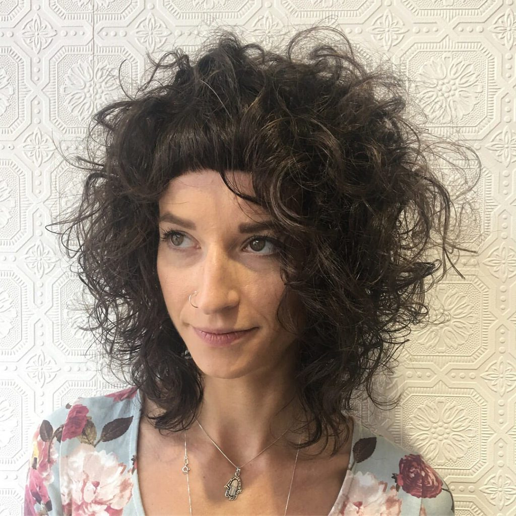 Women's Messy Textured Curly Bob With Micro Bangs On Brunette Hair Intended For Curly Brunette Bob Hairstyles With Bangs (View 20 of 20)