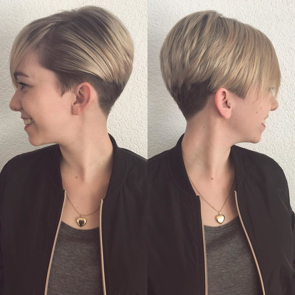 Women's Short Blonde Graduated Pixie With Full Side Swept Bangs Throughout Sweeping Pixie Hairstyles With Undercut (View 18 of 20)
