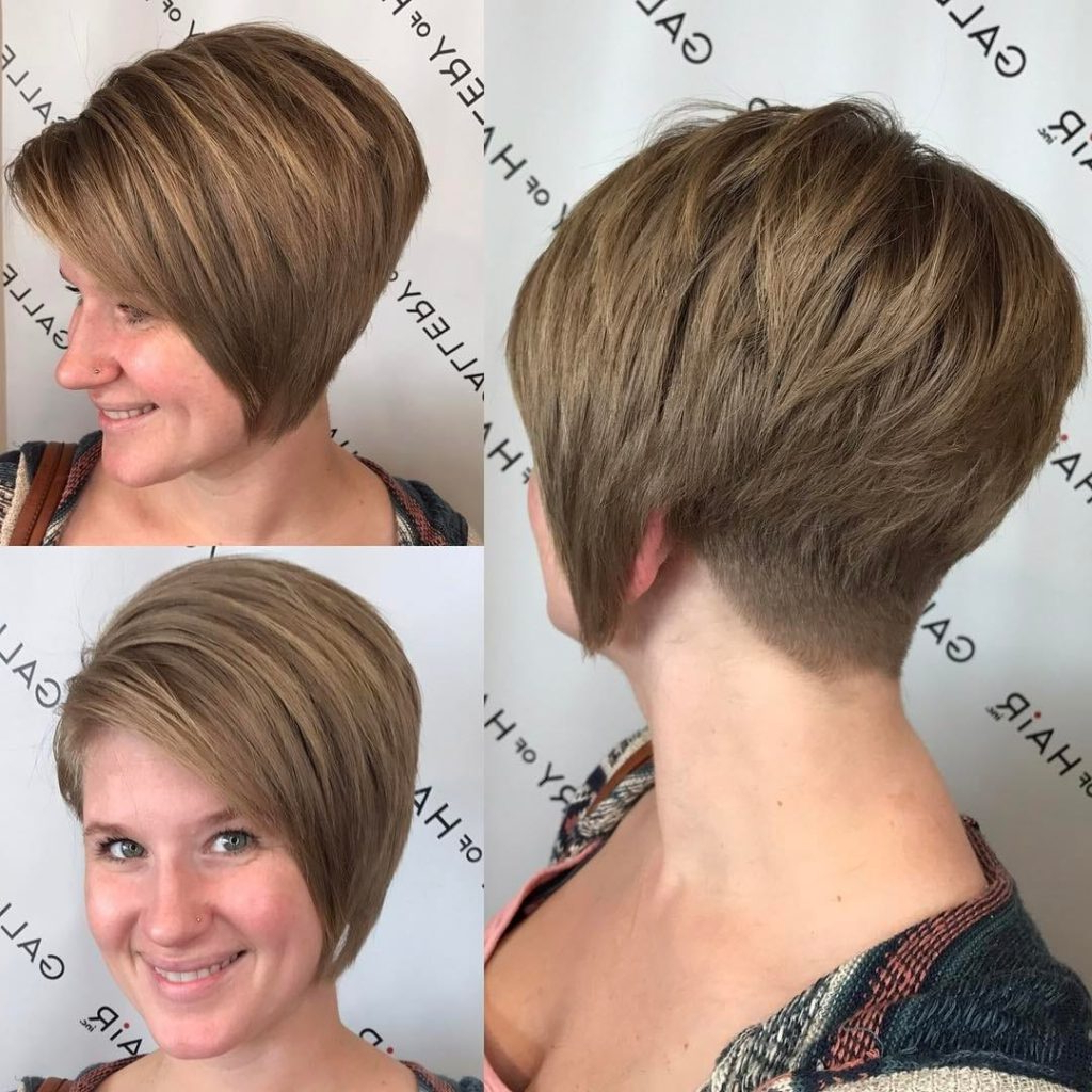 Women's Stacked Asymmetrical Bob With Side Swept Bangs And Tapered Within Two Tone Stacked Pixie Bob Haircuts (View 20 of 20)