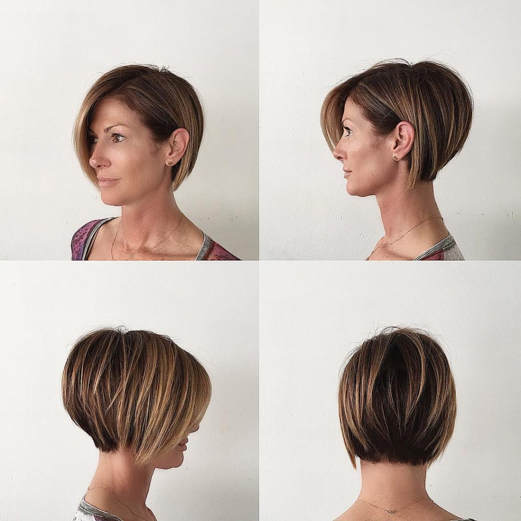 Women's Stacked Layered Bob With Long Side Swept Bangs And Brunette Pertaining To Inverted Bob Hairstyles With Swoopy Layers (View 20 of 20)