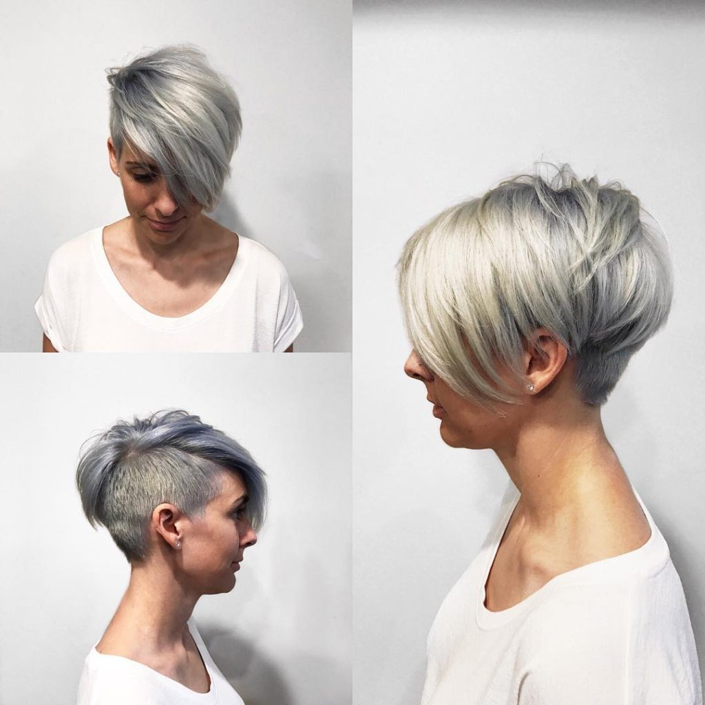 Women's Textured Platinum Undercut Pixie With Long Side Swept Bangs Inside Long Blonde Pixie Haircuts With Root Fade (View 7 of 20)