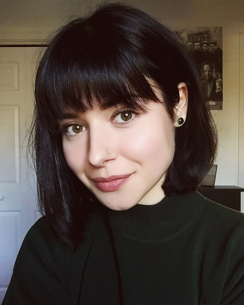 Black Hair With Caramel Highlights Underneath Keep Your Bangs Bang Inside Short Ruffled Hairstyles With Blonde Highlights (View 12 of 20)