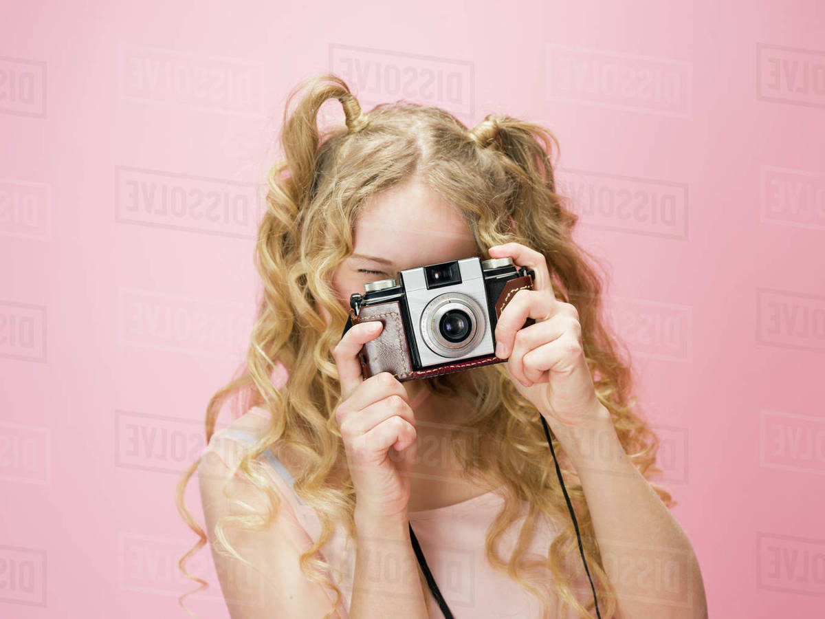 Portrait Playful Young Woman With Curly Blonde Hair Photographing Throughout Playful Blonde Curls Hairstyles (View 15 of 20)