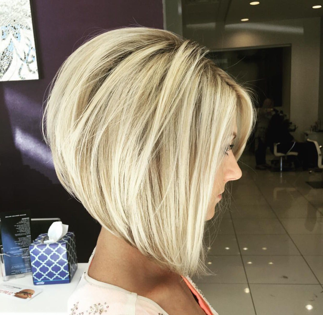 Stacked, Layered Bob With Bangs Framing The Face– Short In The Back Within Honey Blonde Layered Bob Hairstyles With Short Back (View 20 of 20)