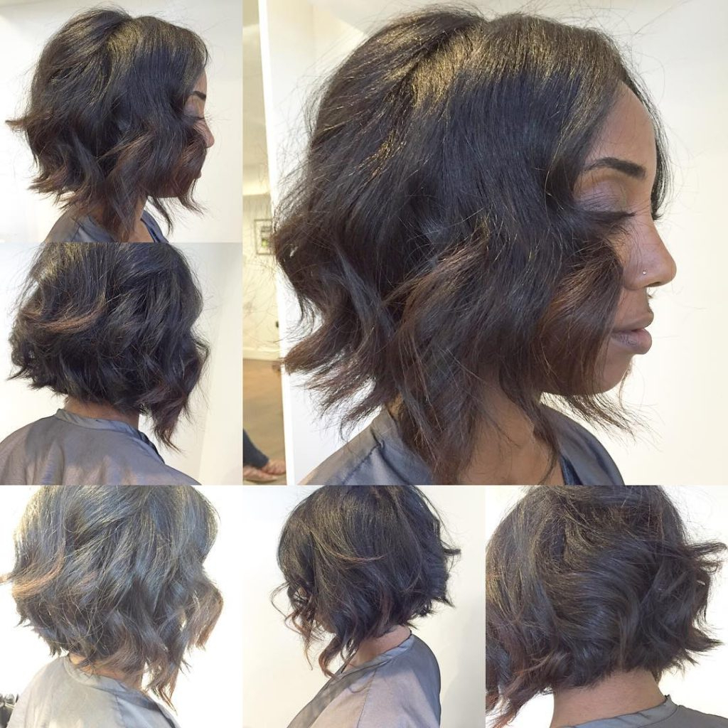 Women's Black Angled Bob With Textured Waves And Brunette Highlights Intended For Angled Ash Blonde Haircuts (View 19 of 20)