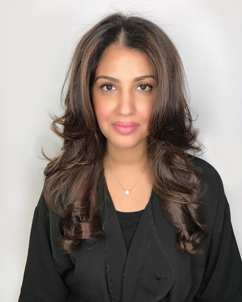 Women's Long Layered Hair With Blowout Styling And Curled Tips On Intended For Perfect Blow Out Hairstyles (View 20 of 20)