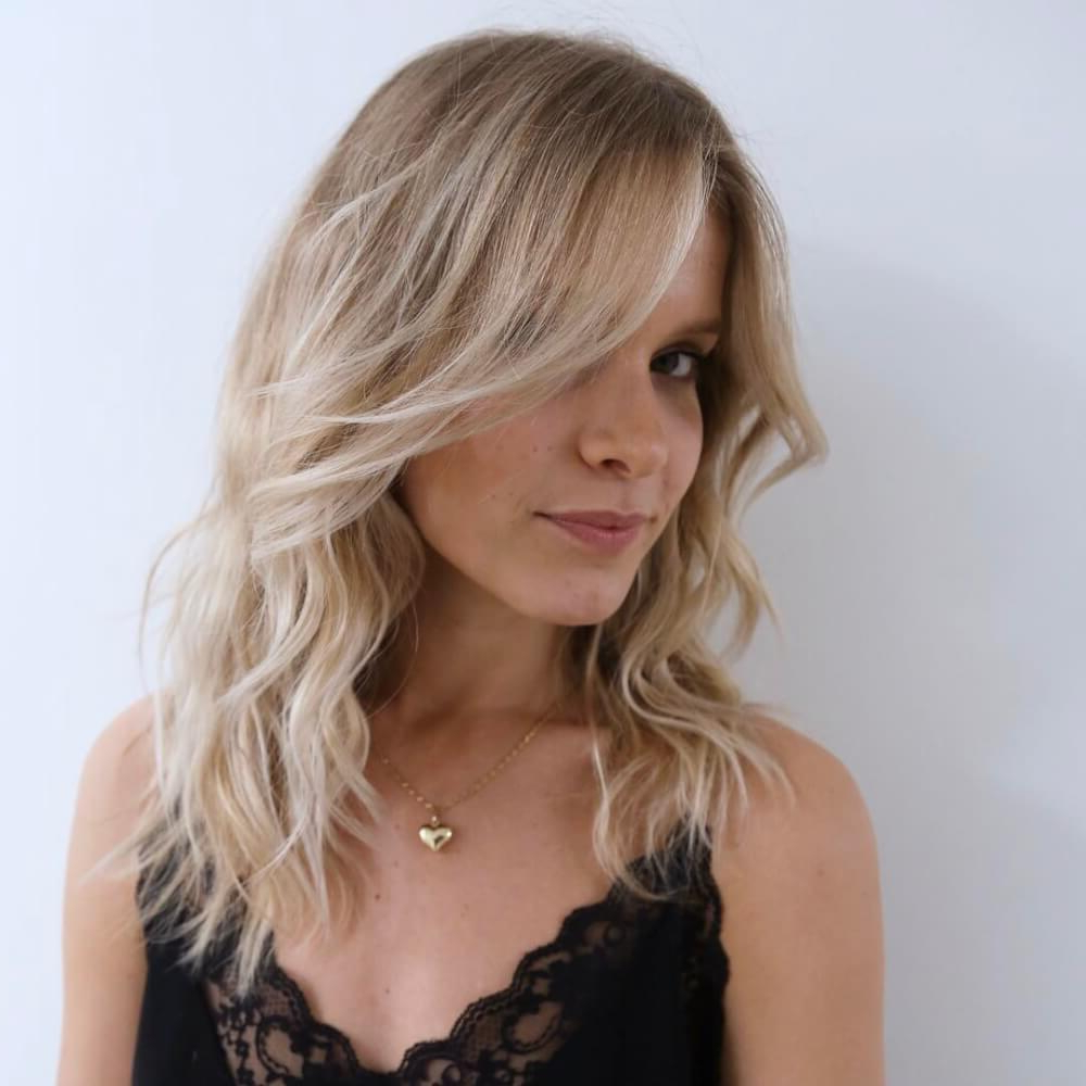 51 Stunning Medium Layered Haircuts (Updated For 2019) Throughout Fashionable Layered Medium Hairstyles With Side Bangs (View 3 of 20)