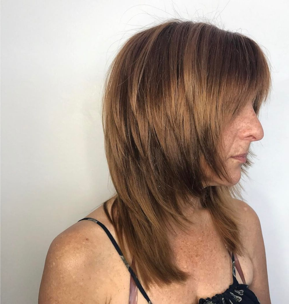 51 Stunning Medium Layered Haircuts (Updated For 2019) Throughout Newest Layered Medium Hairstyles With Side Bangs (View 4 of 20)