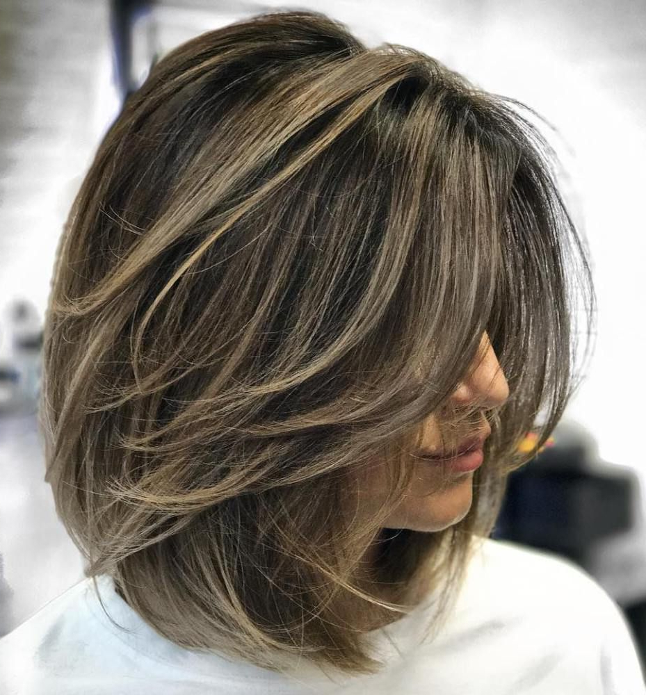 Featured Photo of Feathered Brunette Lob Haircuts