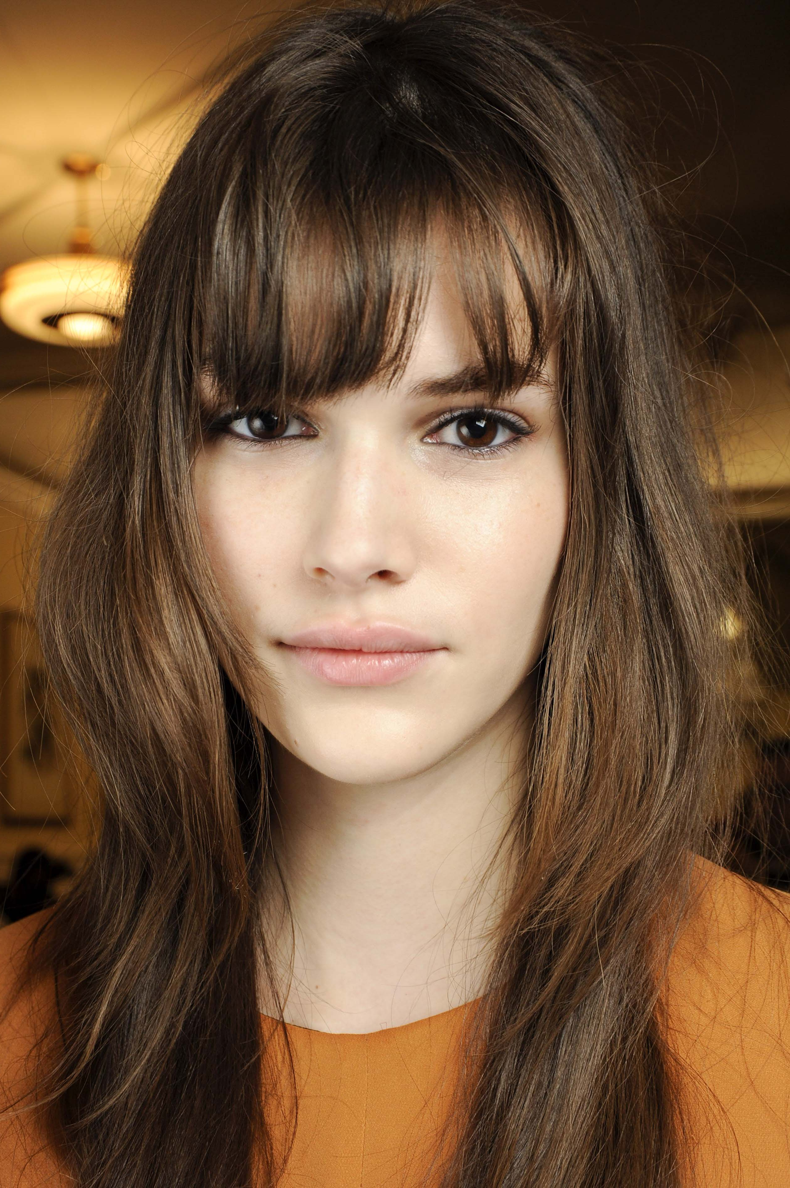 Latest Very Medium Haircuts With Long Bangs Regarding The Most Fashionable Hairstyles For Oblong Faces To Try Now (View 11 of 20)