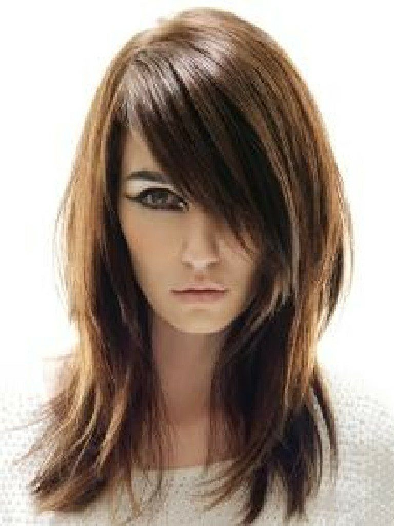 Medium Length Straight Hairstyle With Side Swept Bangs And Layers In Most Up To Date Medium Haircuts With Side Fringe (View 16 of 20)