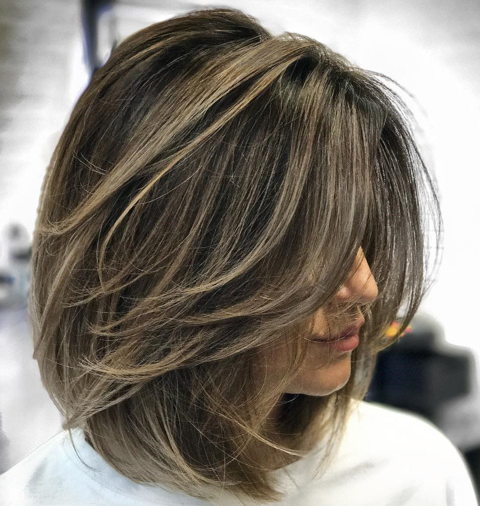 Mid Intended For Well Known Swoopy Layers Hairstyles For Voluminous And Dynamic Hair (View 18 of 20)