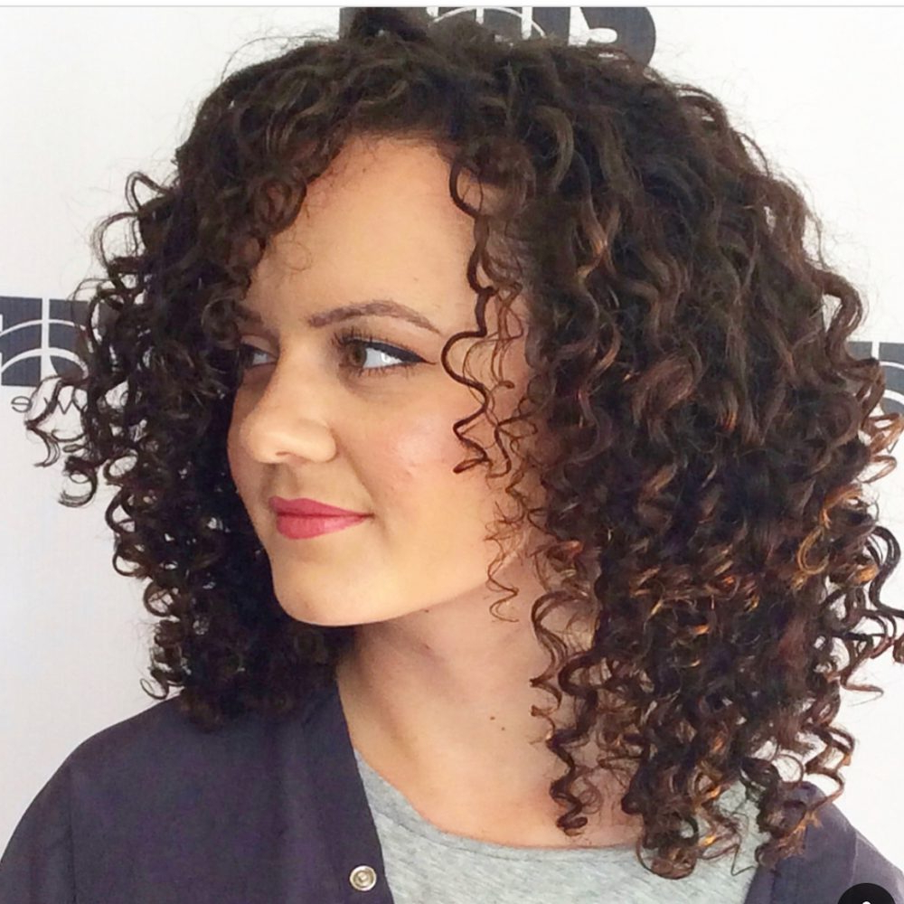Most Popular Curly Medium Hairstyles With Bangs Inside 30 Gorgeous Medium Length Curly Hairstyles For Women In  (View 13 of 20)
