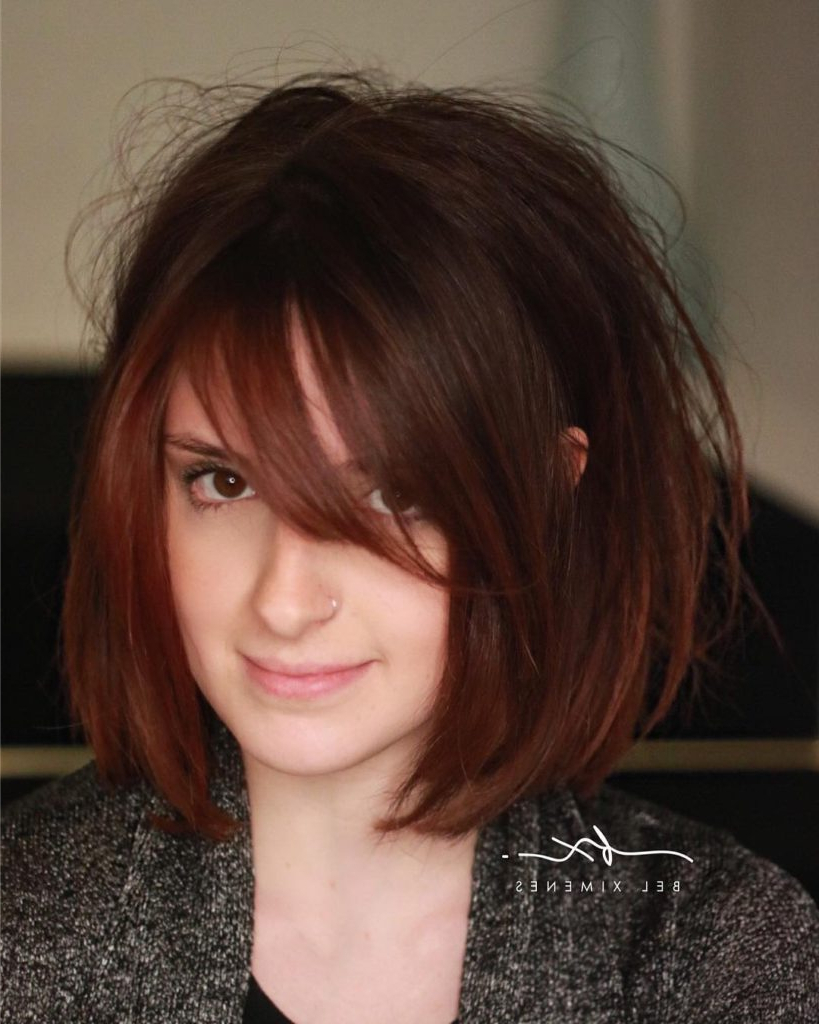 Most Popular Medium Hairstyles With Side Swept Bangs Within Women's Shaped Bob With Side Swept Bangs And Messy Blowout Texture (View 12 of 20)