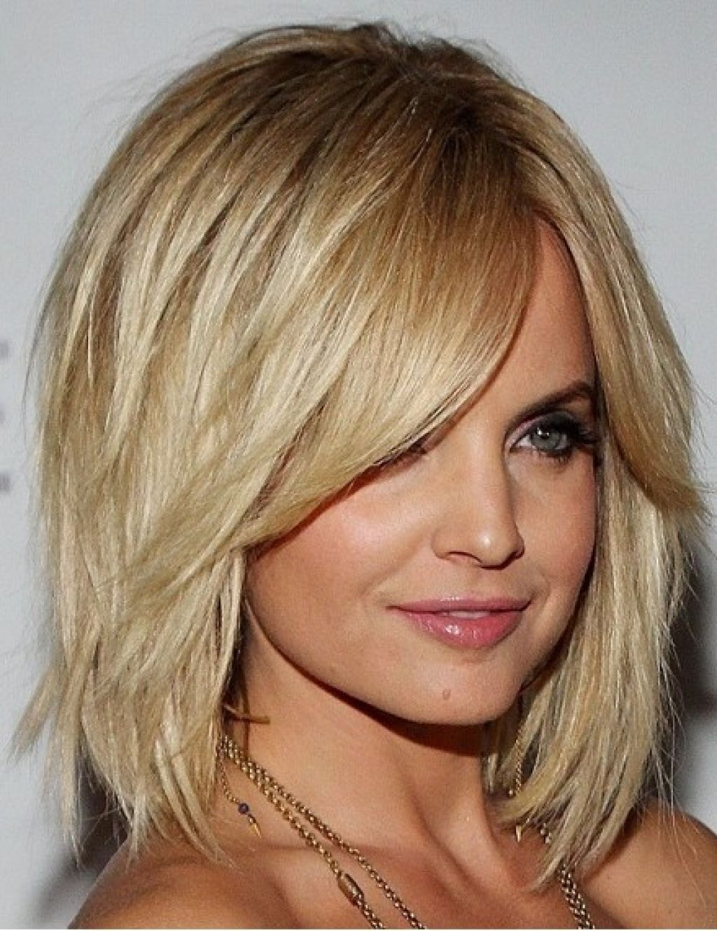 Newest Medium Haircuts With Swoop Bangs Throughout Choppy Bob Style For Mid Length Hair On Women (View 8 of 20)