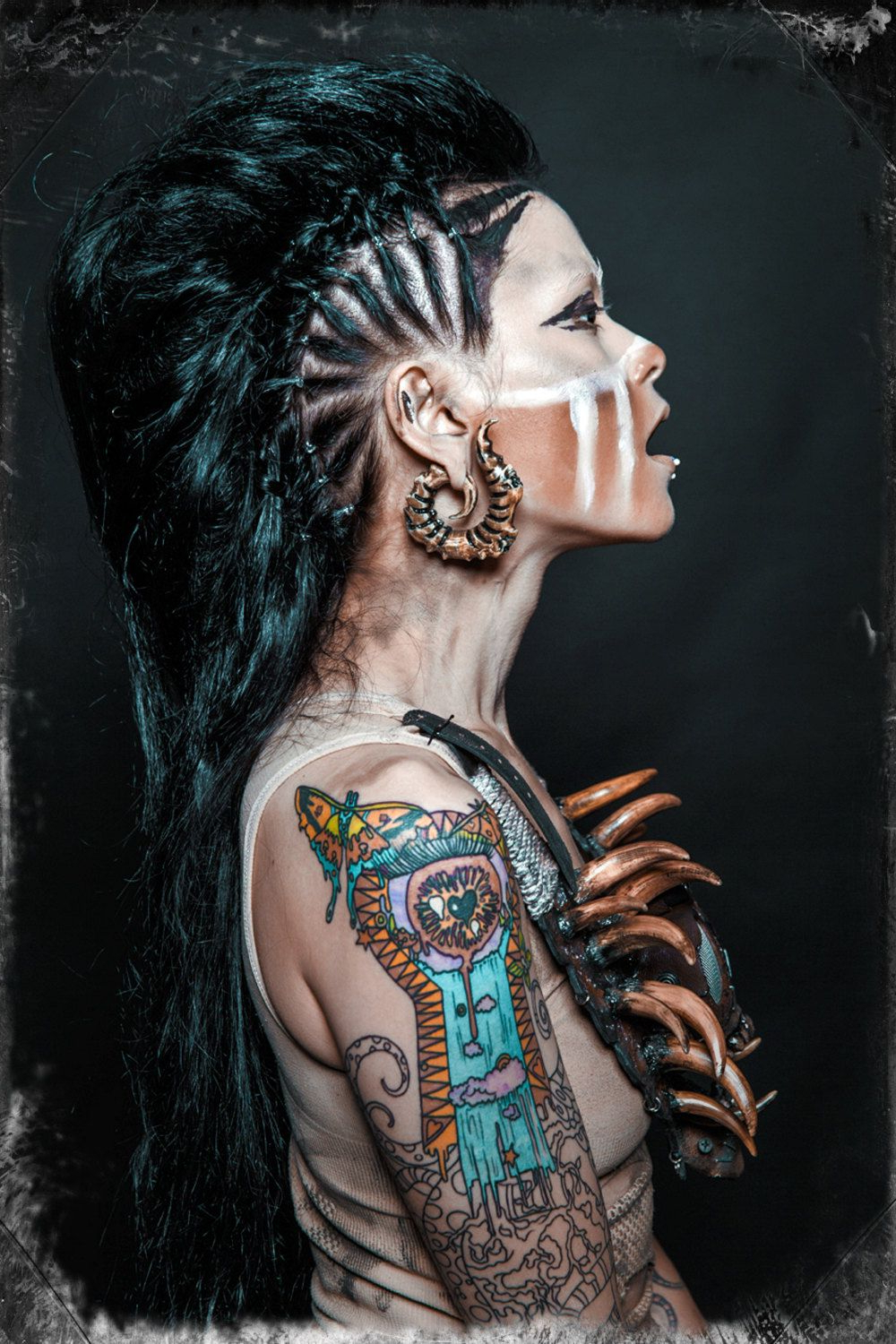 Popular Tattoo You Tonight Faux Hawk Hairstyles For Tribal Inspired Tooth Necklace And Make Up With Faux Hawk (View 11 of 20)
