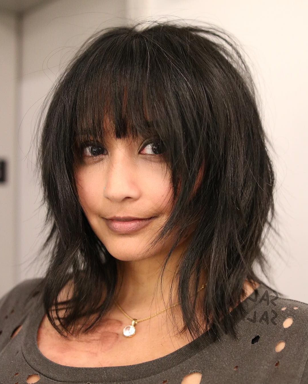 This Dark Voluminous Face Framing Shag Cut With Fringe Bangs Is A Inside Current Voluminous Wavy Layered Hairstyles With Bangs (View 4 of 20)