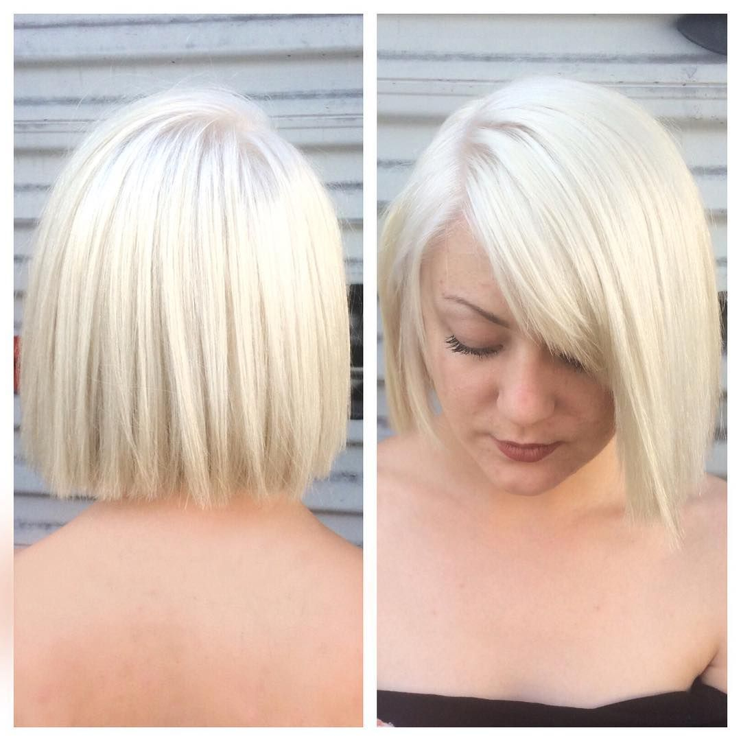 This Platinum Blunt Cut Bob With Textured Ends And Side Swept Bangs Pertaining To Latest Platinum Layered Side Part Hairstyles (View 13 of 20)