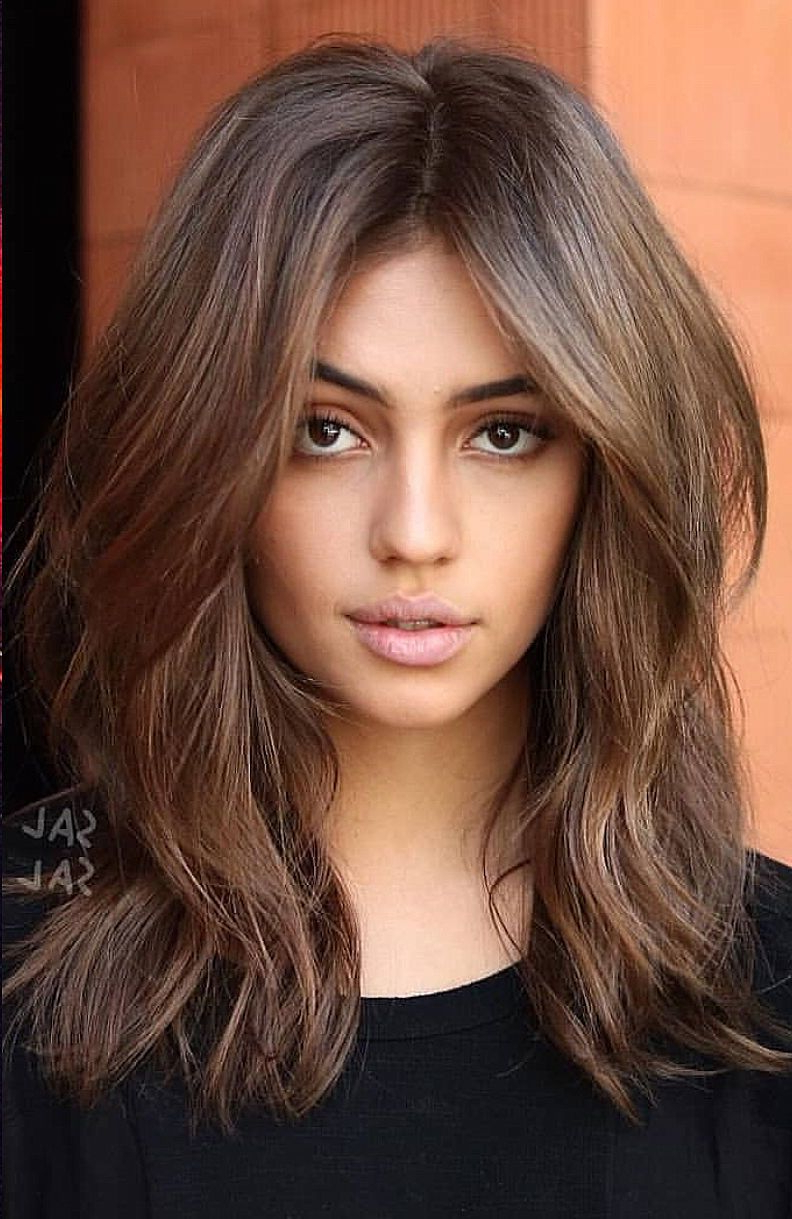 Voluminous Hair With Several Layers And Texture #haircuts For Well Liked Medium Haircuts For Voluminous Hair (View 20 of 20)