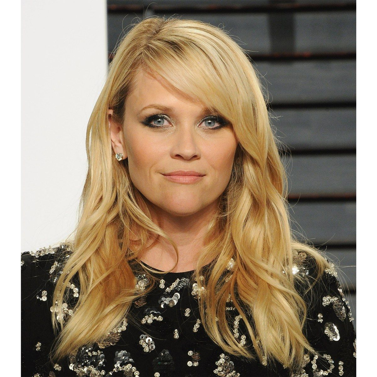 Well Known Medium Hairstyles Swept Off The Face With When It Comes To Reese Witherspoon's Mid Length Hair That Is Heavily (View 11 of 20)