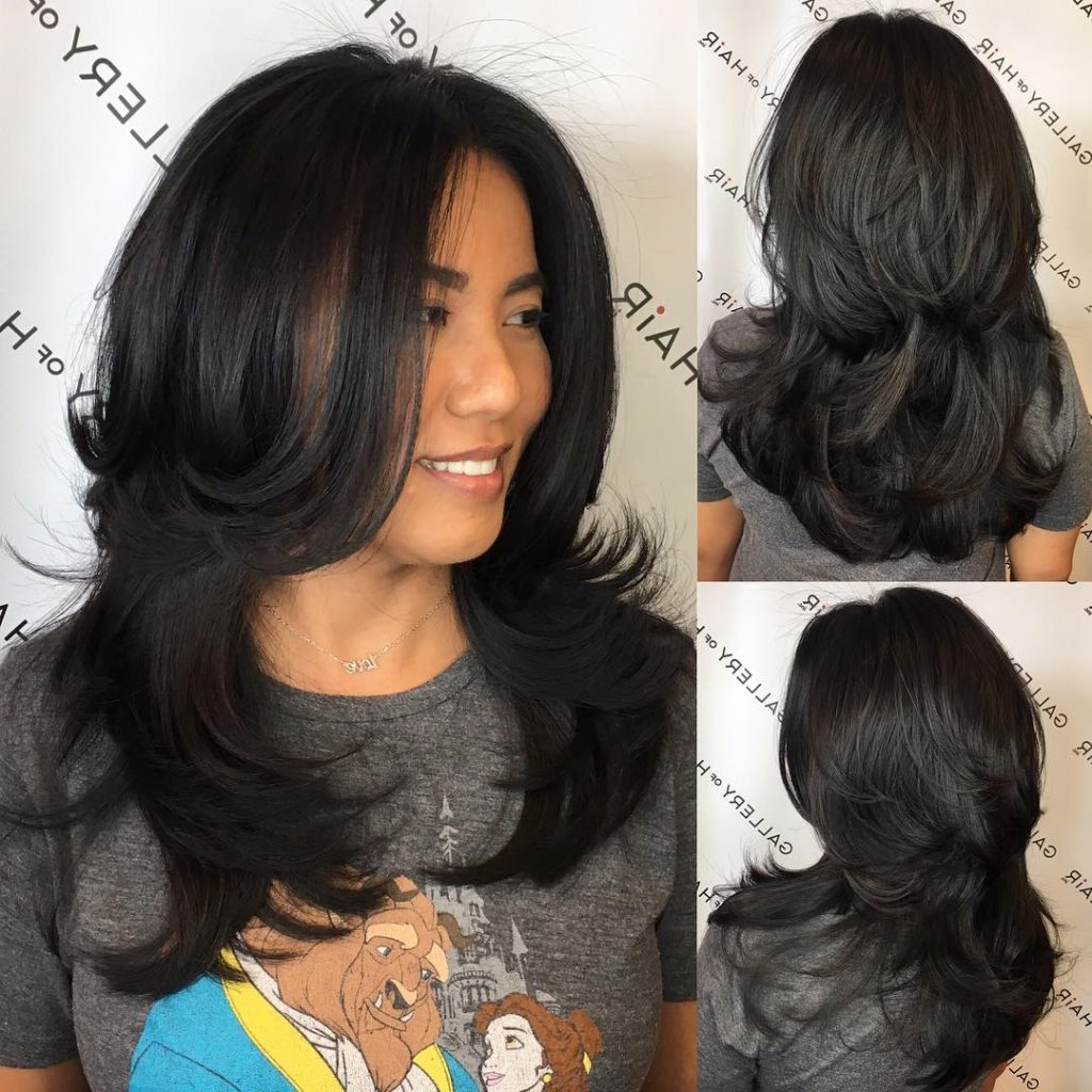 Women's Black Shaggy Razor Cut With Long Layers And Flipped Ends For Newest Long Bob Hairstyles With Flipped Layered Ends (View 19 of 20)