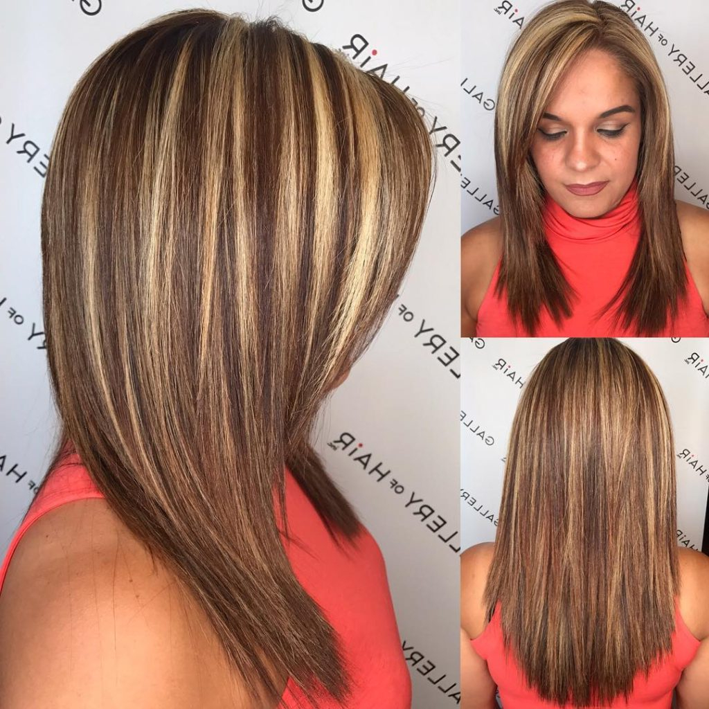 Women's Layered Cut With Textured Ends And Bold Chunky Highlights Regarding Fashionable Shoulder Length Haircuts With Flicked Ends (View 16 of 20)