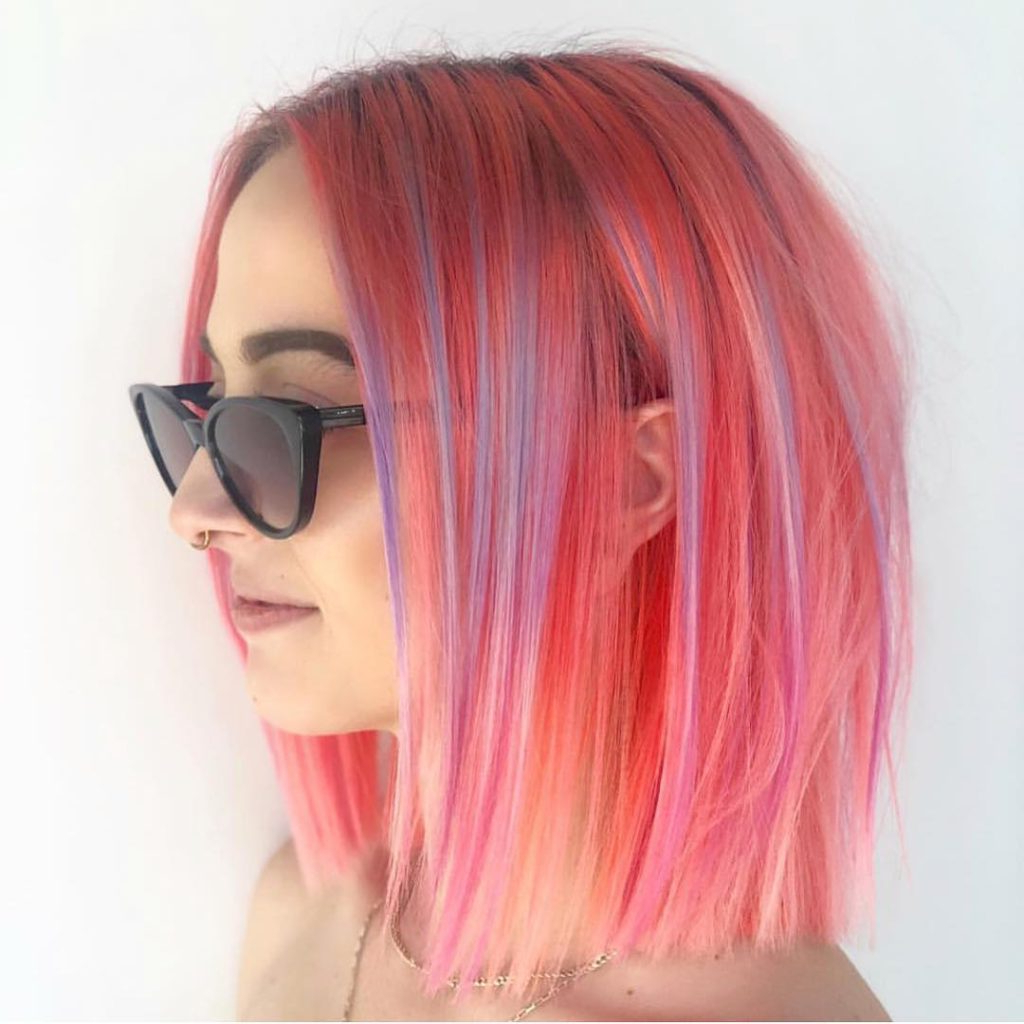 Women's Sleek Blunt Bob With Pink Fruit Punch Hair Color And Pastel Regarding Current Purple Medium Hairstyles (View 20 of 20)