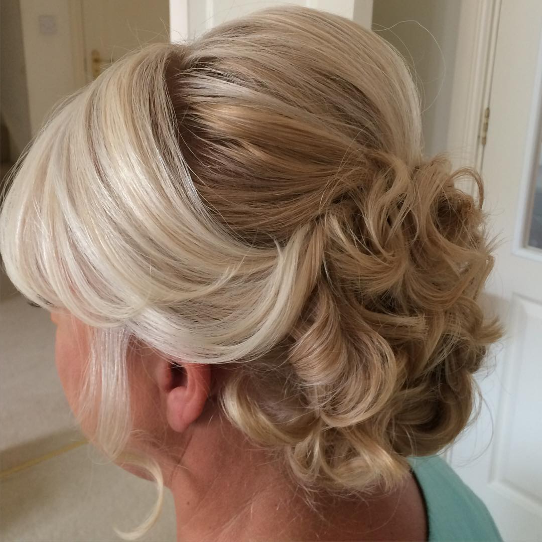 50 Ravishing Mother Of The Bride Hairstyles Pertaining To Most Up To Date Destructed Messy Curly Bun Hairstyles For Wedding (View 5 of 20)