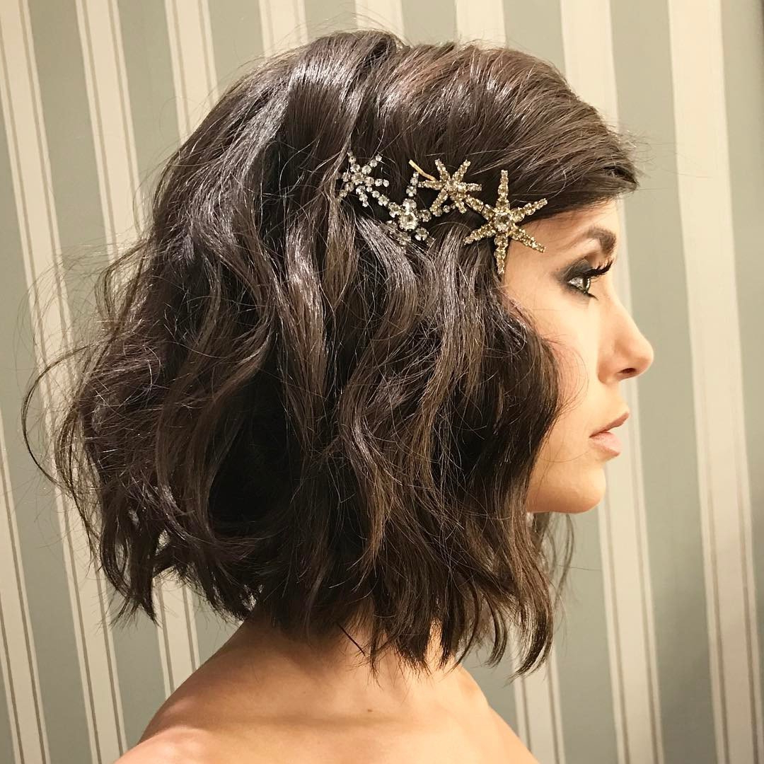 Add Some Edge To Your Lobpinning A Sparkly Brooch On One Side Within Preferred Pinned Brunette Ribbons Bridal Hairstyles (View 11 of 20)