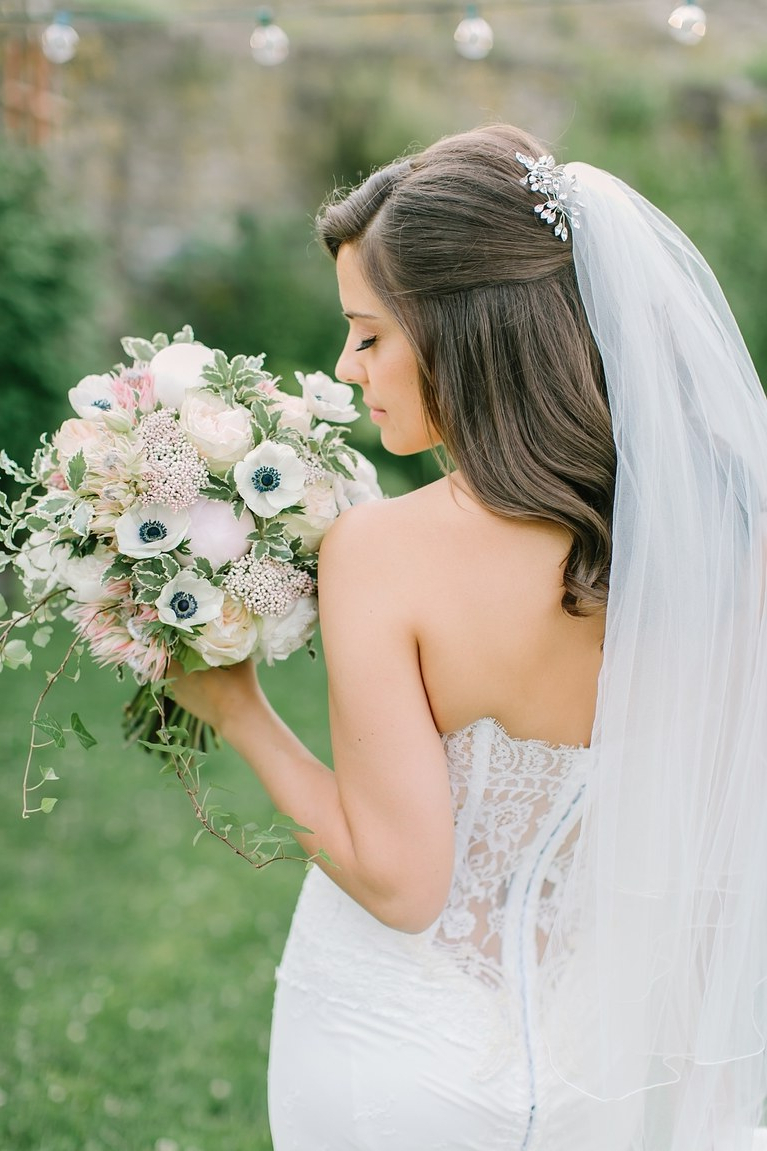 Best And Newest Pulled Back Half Updo Bridal Hairstyles With Comb For Half Up, Half Down Wedding Hairstyles For Every Type Of Bride (View 11 of 20)