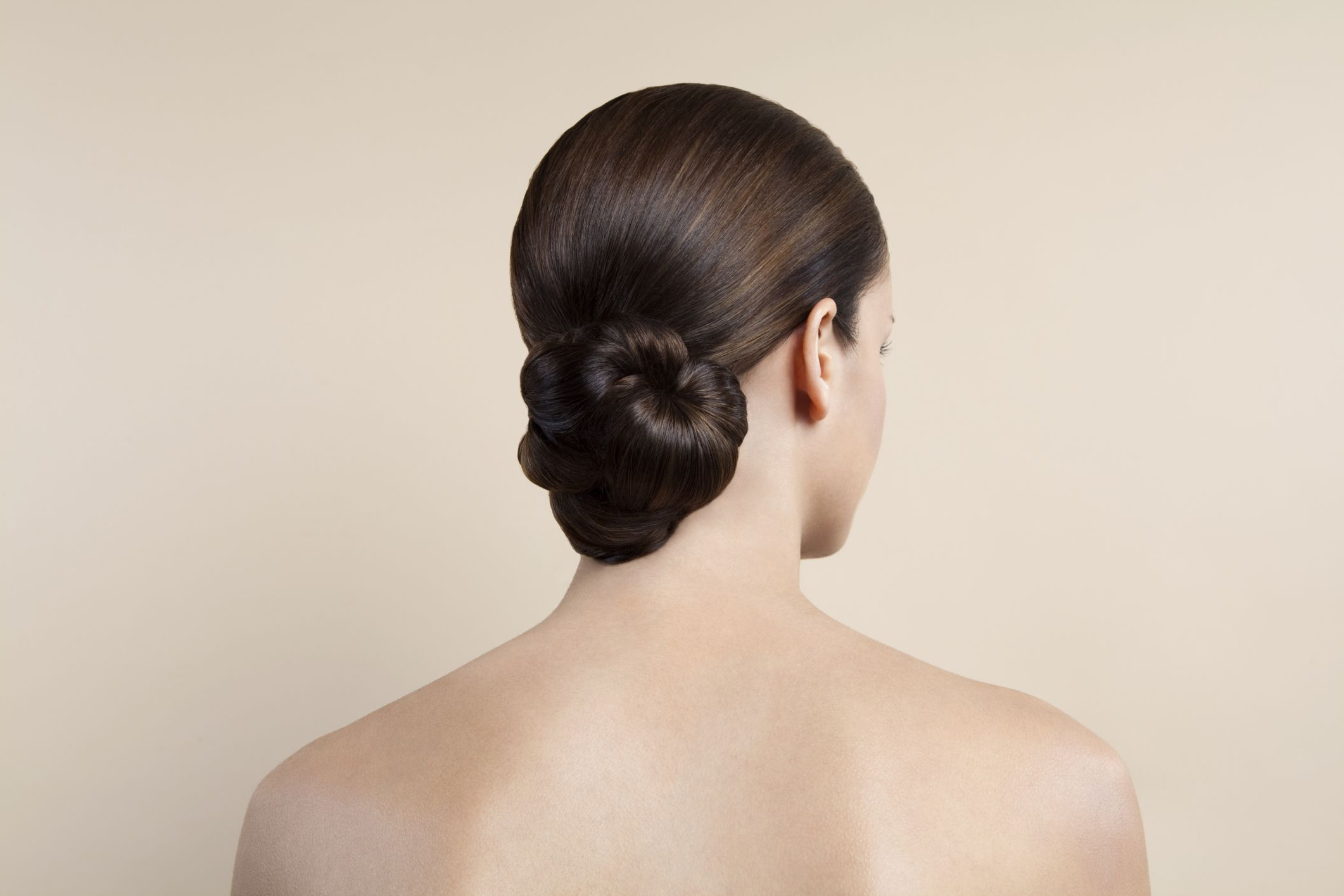 Best Job Interview Hairstyles For Women With Recent Sleek French Knot Hairstyles With Curls (View 4 of 20)