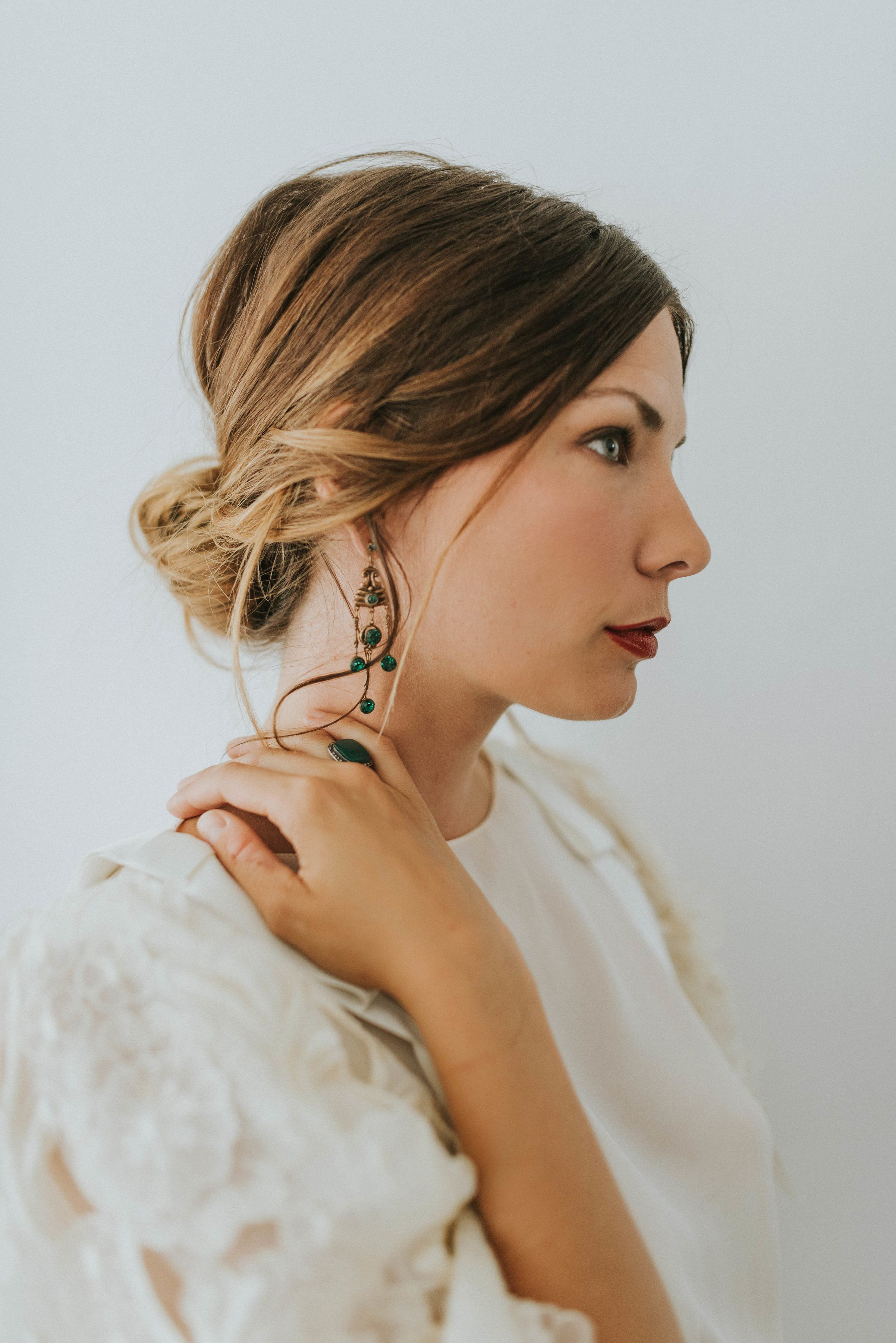 Bold Bridal Beauty Look With A Soft Low Messy Bun Hairstyle Intended For Well Known Bold Blonde Bun Bridal Updos (View 7 of 20)