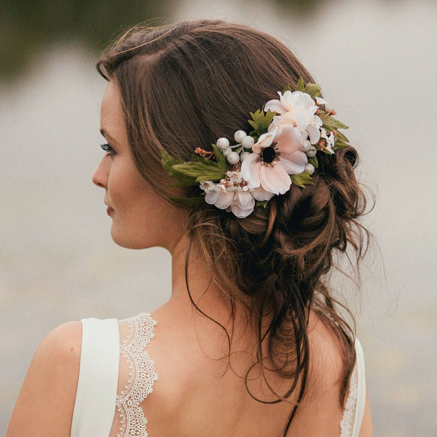 Featured Photo of Undone Low Bun Bridal Hairstyles With Floral Headband