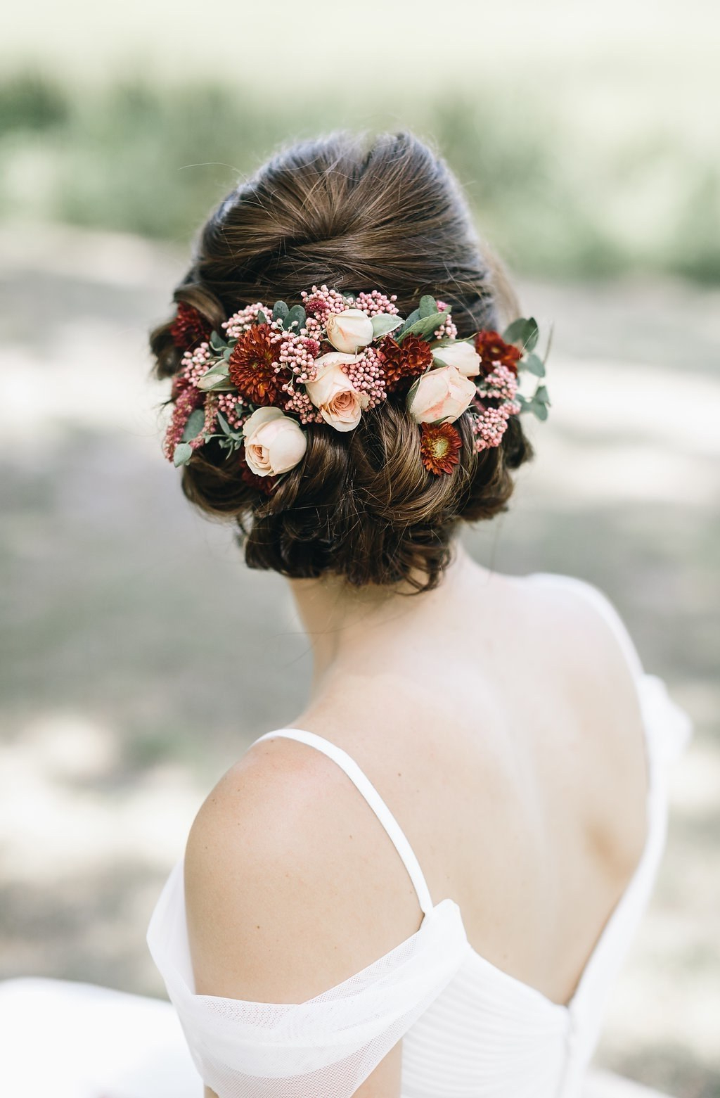 Brides Throughout Fashionable Undone Low Bun Bridal Hairstyles With Floral Headband (View 6 of 20)