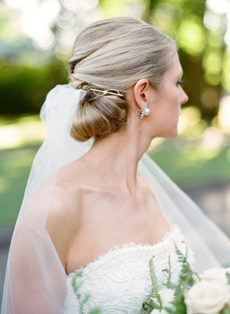 Brides Throughout Preferred Sleek Bridal Hairstyles With Floral Barrette (View 8 of 20)